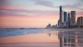 Tall City Buildings Near Beach Shore during Sunset Royalty Free Stock Photos