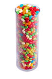 Tall clear jar of jelly beans. Vertical view of tall clear jar of colorful jelly beans Stock Images