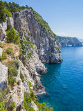 Tall cliffs and clear blue water Stock Photo