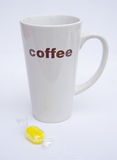 Tall coffee cup with sherbet sweet. Royalty Free Stock Photography