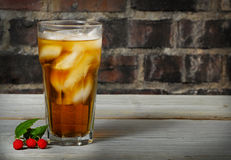 Tall cold glass of raspberry ice tea Royalty Free Stock Photos