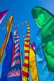Tall, colorful banners fluttering in the wind Stock Image