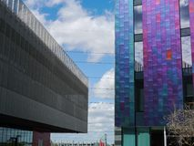 Tall colourful building by docklands. Tall colorful building sitting next to his boring grey mate Royalty Free Stock Photography