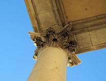 Tall columns. Tal columns with a corinthian holding the roof corner up Stock Images