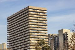 Tall Condominium Building Against Blue Sky Background royalty free stock images
