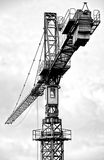 Tall construction crane. A tall construction crane against the sky stock images