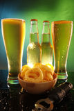 Tall cool beer and onion rings Stock Photo