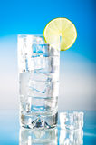 Tall cool iced drink with lime royalty free stock images