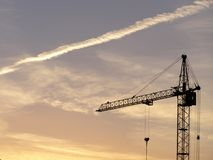tall crane. Photo of tall crane with sunrise background Royalty Free Stock Images