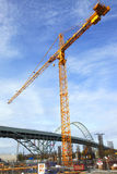 Tall crane & construction site. Royalty Free Stock Images