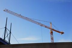 Tall crane at work. Stock Photos