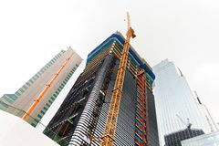 Tall crane working at a construction site of a new financial center - Seoul, South Korea Stock Photos