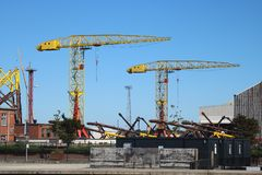 Tall cranes in shipbuilding yard royalty free stock photography