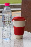 Tall cup and bottle Stock Photo