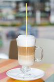Tall cup of coffee latte with wipped cream. Tall cup of fresh coffee latte with wipped cream Stock Images