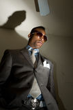 Tall dark and handsome. A young african american in a stylish suit and dramatic lighting Stock Images