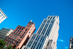 Tall downtown business buildings on a clear summer day Royalty Free Stock Image