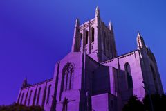 Tall downtown Los Angeles Catholic Church in twilight purple haze. Twilight with a purple haze at the historic downtown Los Angeles Catholic Church Stock Photos