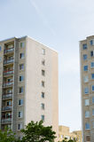 Tall dull uniform concrete communist style apartment house blocks.  Royalty Free Stock Images