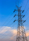 A tall electrical tower. Over a blue sky background Stock Photos