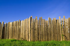 Tall fence under a blue sky Royalty Free Stock Photos