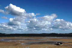 Empty beach. With a cloudy sky Royalty Free Stock Photography