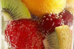 Tall fresh drink. A still image of a fruits and bubles Royalty Free Stock Photography