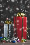 Tall gift boxes decorate with colourful bows and small Christma royalty free stock photos