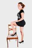Tall girl in black dress. Royalty Free Stock Images