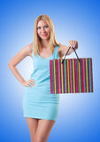 The tall girl after good shopping on white Royalty Free Stock Photography