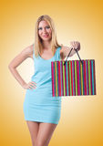The tall girl after good shopping on white Royalty Free Stock Image