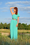 Tall girl in nature. Beautiful tall woman standing in nature Royalty Free Stock Photo