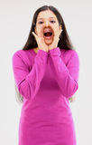 Tall girl in pink dress with shouting expression Stock Photo