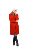 Tall girl in red coat and white hat Royalty Free Stock Photos