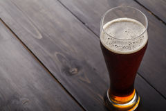 Tall glass of amber ale Stock Photos