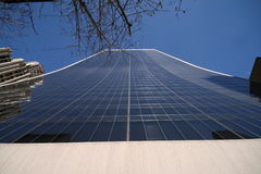 Tall glass building. Up view of a tall glass building in New York City Stock Photo