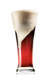 Tall glass of dark beer with foam Royalty Free Stock Photography