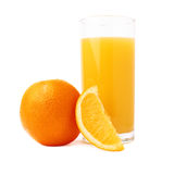 Tall glass filled with the orange juice and fruits Stock Image