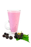 Milkshake in a tall glass with blackberry and leaf Stock Photography