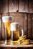 Tall glass and a mug of light beer Stock Image