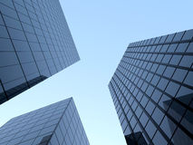 Tall glass skyscraper. Three tall glass skyscrapers on the blue sky Royalty Free Stock Photo