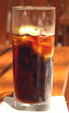 Tall glass of soda. A close up view of a tall glass of refreshing soda on ice Royalty Free Stock Photography