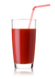 Tall glass of tomato juice with a red straw Royalty Free Stock Photos