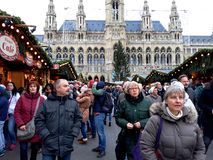 Tall gothic building of Vienna city hall Rathaus and traditional Christmas market. Vienna, Austria - December 16, 2017: Tall gothic building of Vienna city hall Stock Images