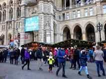 Tall gothic building of Vienna city hall Rathaus and traditional Christmas market. Vienna, Austria - December 16, 2017: Tall gothic building of Vienna city hall Stock Photo