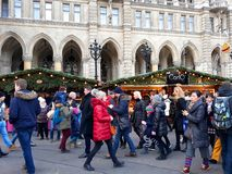 Tall gothic building of Vienna city hall Rathaus and traditional Christmas market. Vienna, Austria - December 16, 2017: Tall gothic building of Vienna city hall Stock Photos