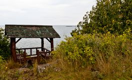 Old rustic patio on the lake shore. Beautiful northern lanscape stock photo