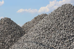 Tall Gravel Rock Piles with Bright Blue Sky Stock Image