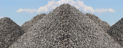 Tall Gravel Rock Piles with Bright Blue Sky Stock Images