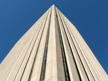 Tall Gray Skyscraper. Massive stone office tower royalty free stock photography